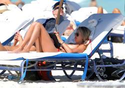 http://img260.imagevenue.com/loc160/th_260197967_lauren_stoner_bikini_topless_march19_2012_35_123_160lo.jpg