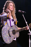 http://img260.imagevenue.com/loc185/th_32535_Taylor_swift_performs_her_Fearless_Tour_at_Tiger_Stadium_008_122_185lo.jpg
